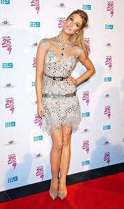 Delta Goodrem completed her sparkly ensemble with a pair of bedazzled nude pointy pumps.