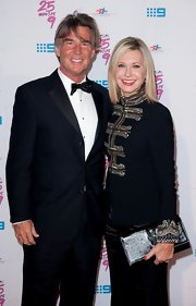 Olivia Newton-John wore a military-inspired jacket at the Richard Wilkins' fundraising event.
