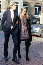 Poppy Delevingne headed to Sir Jocelyn Stevens' memorial service wearing a classy tweed skirt suit under a black coat.