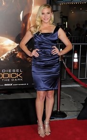 Katee showed off her curves in this deep blue ruched satin dress.