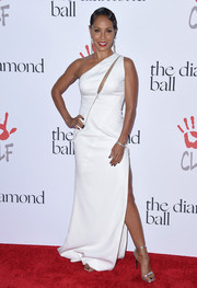 Jada Pinkett Smith was all about edgy glamour in a high-slit, zip-embellished one-shoulder gown by Zuhair Murad at the Diamond Ball.