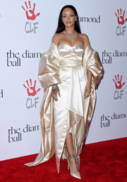 Rihanna got majorly glammed up in a vintage champagne-hued Dior Couture strapless gown and a matching voluminous shawl for the Diamond Ball.