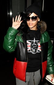 Rihanna exuded a cool, urban vibe in a dark color-blocked coat.