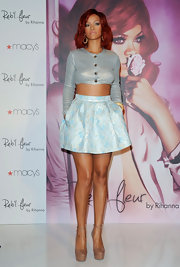 Rihanna stood tall at her fragrance launch in nude ankle strap platform pumps.
