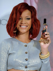 Rihanna rocked dark maroon nail polish, which was the perfect match for her red tresses.