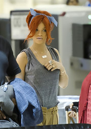 Rihanna can look fantastic with just a few bobby pins and a scarf and she proved it at LAX preparing for a flight.
