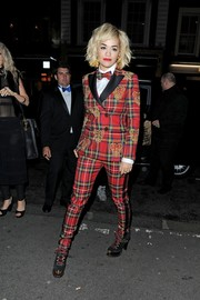 Rita Ora looked a little quirky in her red plaid Moschino pantsuit during the Rimmel London 180 Years of Cool party.
