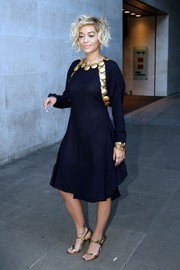 Rita Ora visited the BBC Studios looking sassy in a gold disc-embellished navy dress.
