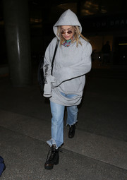Rita Ora sealed off her edgy airport look with a pair of combat boots by Louis Vuitton.