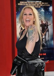 Lita Ford gave fans a glimpse of her huge skull design tattoo while posing on the red carpet.
