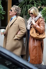 Penny Lancaster carried a suede tote while roaming around London with husband Rod Stewart.