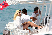 Penny Lancaster matched her outfit with a pair of thong sandals while chilling on a yacht with her family.