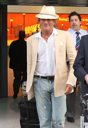 Rod looked casual and stylish in distressed jeans, a neutral blazer and a classic fedora.