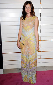 Alexis Bledel complemented her feminine pastel knit dress with a gold satin frame clutch.