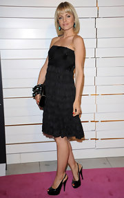 Mena Suvari paired her black cocktail dress with sparkly black peep-toe slingbacks.