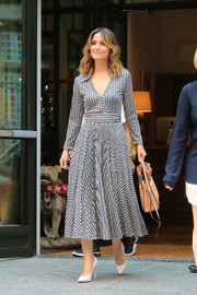 Rose Byrne headed out in New York City looking stylish in a V-print wrap dress by Valentino.