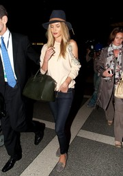 Rosie Huntington-Whiteley kept it comfy with a pair of gray Aquazzura Corsini smoking slippers.