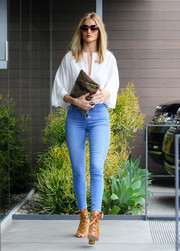 Rosie Huntington-Whiteley styled her outfit with camel-colored lace-up boots by Gianvito Rossi.