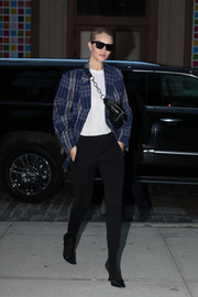 Rosie Huntington-Whiteley accessorized with a black leather belt bag by Alexander Wang, which she wore slung over her shoulder.