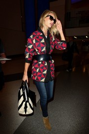 Rosie Huntington-Whiteley cut a stylish figure at LAX in her Etoile Isabel Marant quilted coat.
