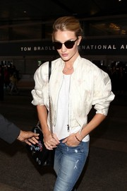Rosie Huntington-Whiteley looked a little shy in her Dior sunnies as she made her way through LAX.