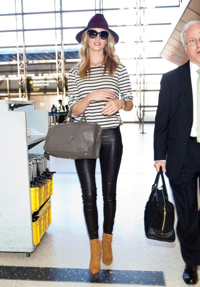 Rosie Huntington Whiteley prepares to depart LAX (Los Angeles International Airport).