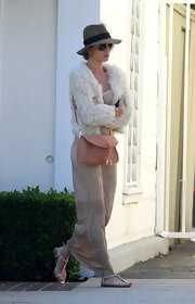 Rosie Huntington-Whiteley wore a furry ivory jacket while out shopping in West Hollywood.