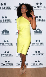 Kelly Rowland promotes TW Steel's oversized watches in this neon single-shoulder number.