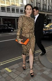 Tallulah Harlech chose a long-sleeve gold and black embroidered dress for the Royal Academy Summer Exhibit.