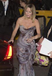 Amanda Holden left Royal Albert Hall in a stunning gray strapless gown with draping and beads.