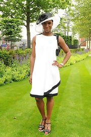 Denise Lewis wore this white shift dress with black trim to the Royal Ascot Racecourse.