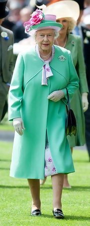 Queen Elizabeth II wore a sleek and sophisticated mint green coat while attending the Royal Ascot Races.