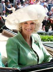 Camilla sported an oversized topper in an ivory color.