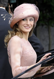 Princess Letizia perfectly paired her embroidered dress with a tulle and feather embellished decorative hat.