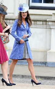 Kate Middleton teamed her lavender brocade coat with navy satin pumps.