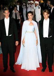 Charlotte Casiraghi looked simply stunning in a pale blue strapless sweetheart gown with a matching cape and gold belt detail.