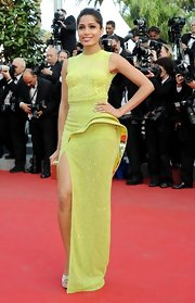 Freida Pinto added faux curves to her look with this dynamic beaded lime evening dress at the 'Rust and Bone' premiere.