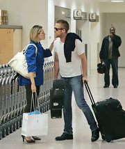 Ryan Gosling landed in LAX while wearing a pair of heavy duty lace-up boots.