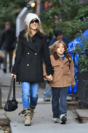 SJP was spotted out and about NYC with son James Wilkie in a black pea coat paired with slouchy tan suede boots.