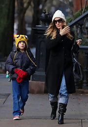 SJP was out and about NYC in black leather slouchy boots.