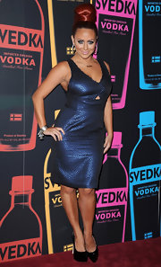Aubrey O'Day wore this iridescent blue cocktail dress with a tiny cutout at the Night of a Billion Reality Stars.