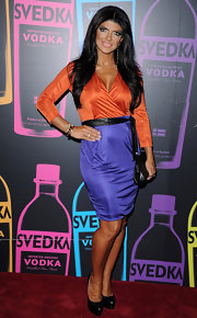 Teresa Giudice looked fun at the Night of a Billion Reality Stars in this orange and purple dress.