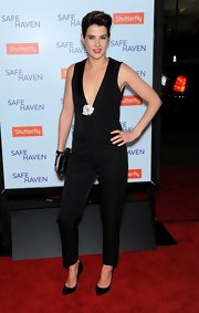 Cobie Smulders took to the red carpet in a deep-plunging black jumpsuit. Daring!