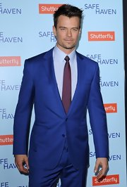 Josh Duhamel added a bit of pop to his blue suit by pairing it with a deep purple tie.