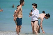 Adam Schulman and Anne Hathaway on Miami beach.