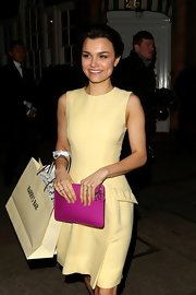 Samantha Barks chose this pastel yellow cocktail dress for her feminine look at the Dior party in London.