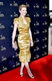 Cate topped off her gold cocktail dress with metallic peep-toe pumps.