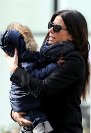 Sandra Bullock bundled up in a cashmere scarf while out at the park with her son.