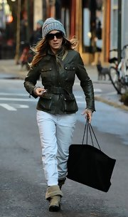 Sarah Jessica Parker stepped out in style with this olive green leather jacket with belted waist.