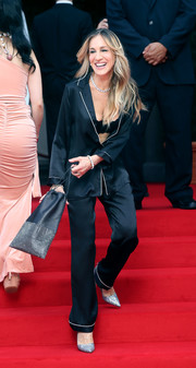 Sarah Jessica Parker walked the red carpet in a black silk pajama set by Intimissimi while filming a commercial for the brand.